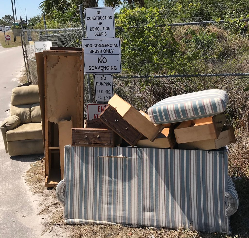 Littering outside Recycle Center gate. -  Vero Beach Florida blog and newsletter.